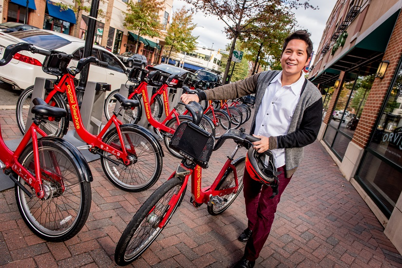 guy-with-capital-bikeshare-at-station