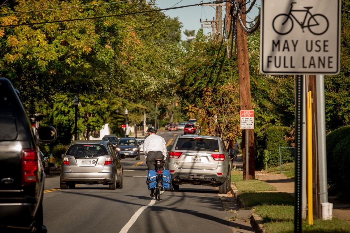 man-biking-business-clothes