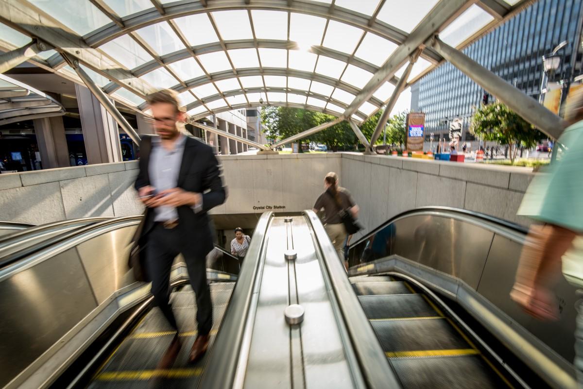man-exiting-metro-escalators