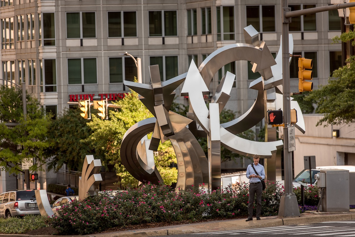 man-under-walk-signal-in-rosslyn