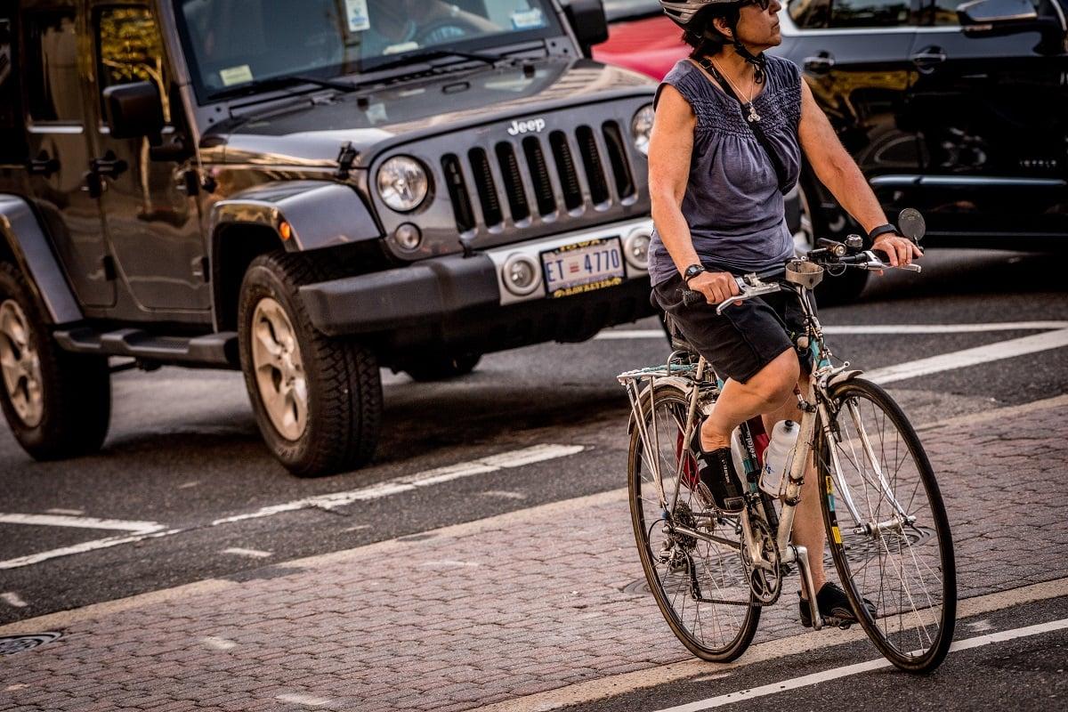 woman-biking-jeep