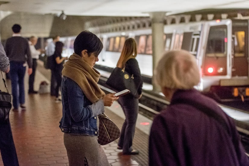 woman-reading-metro-platform.jpg