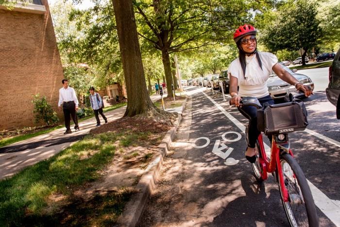Capital Bikeshare rider in protected lane