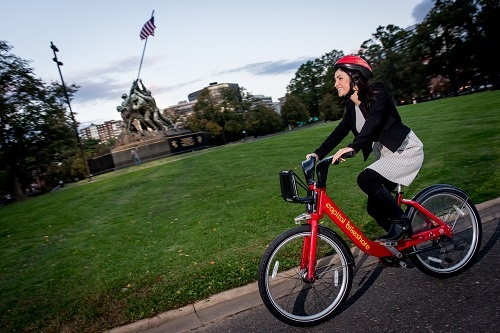 Capital Bikeshare Rider in front of Iwo Jima