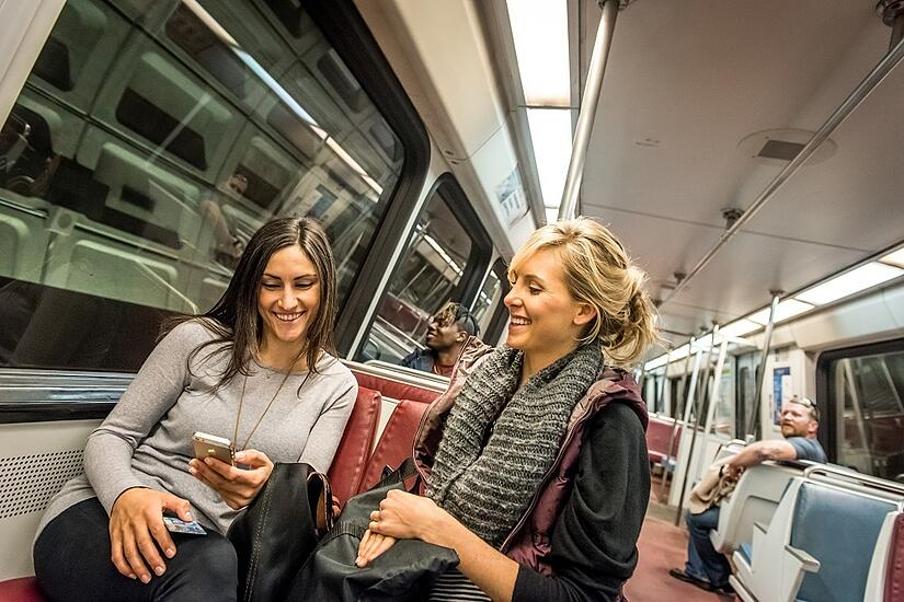 People on metro, using transit apps