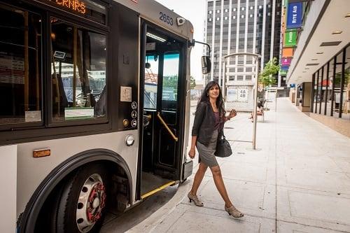 Commuter exiting Metrobus in Arlington, VA