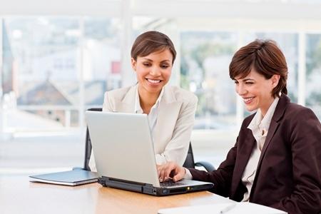 Two women working