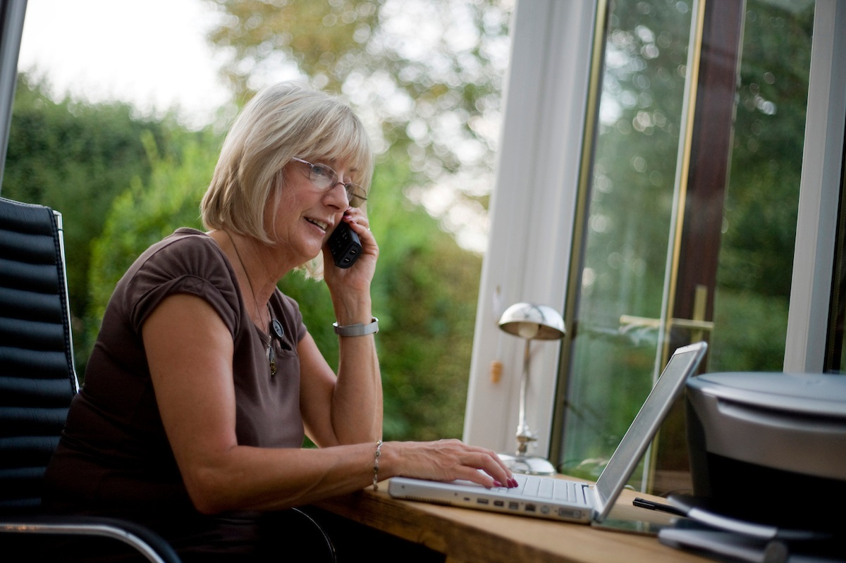 lady-working-from-home-on-phone