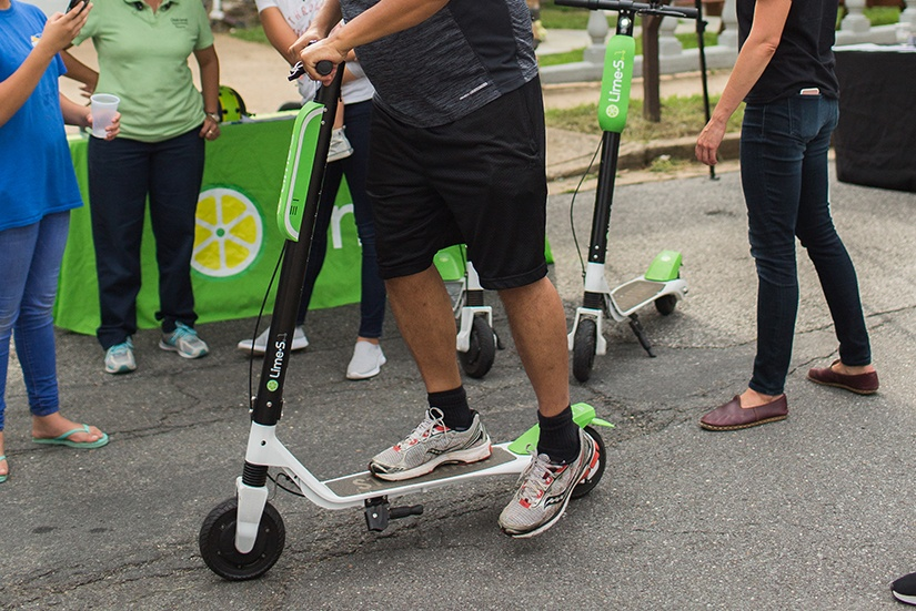 oss-2018-lime-scooter-user-kicking-off-825x551