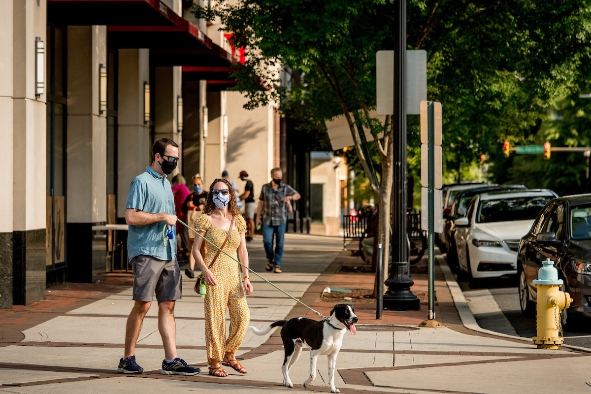residents-in-arlington-walking-with-dog