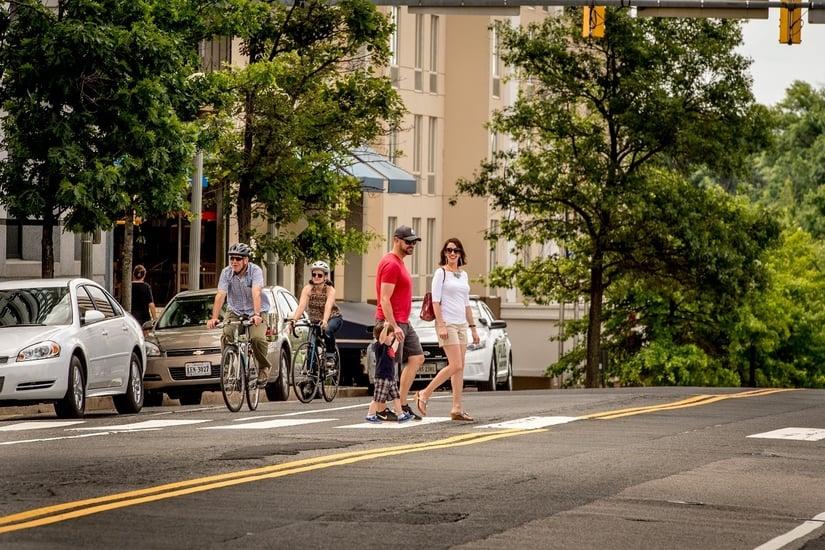 family-walking-courthouse-bikes-too
