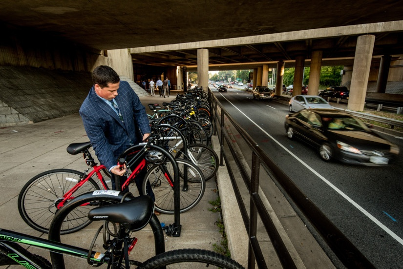 man-locking-bike-business.jpg