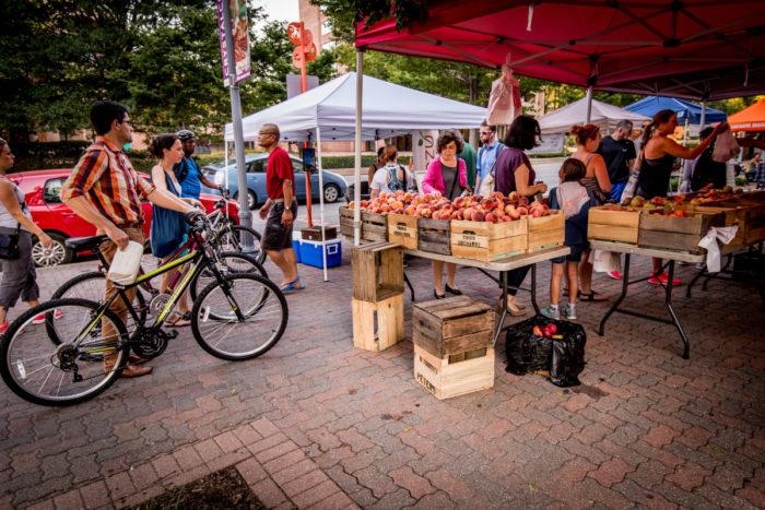 Bikers and Pedestrians at a Farmer's Market